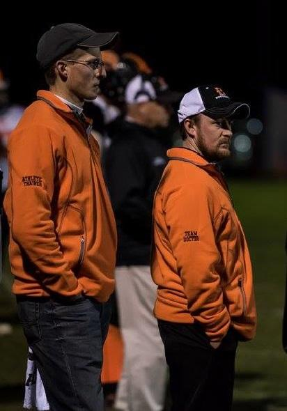 Jake Cross, ATC and Dr. Patrick Healy at a Brewer High School playoff football game