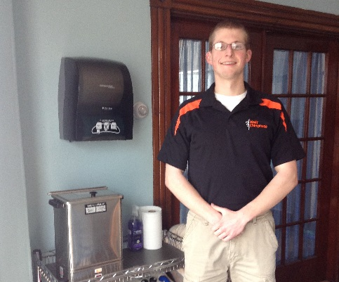 Jake, the Head athletic trainer at Brewer High School and Healy Chiropractic stands with his treatment station