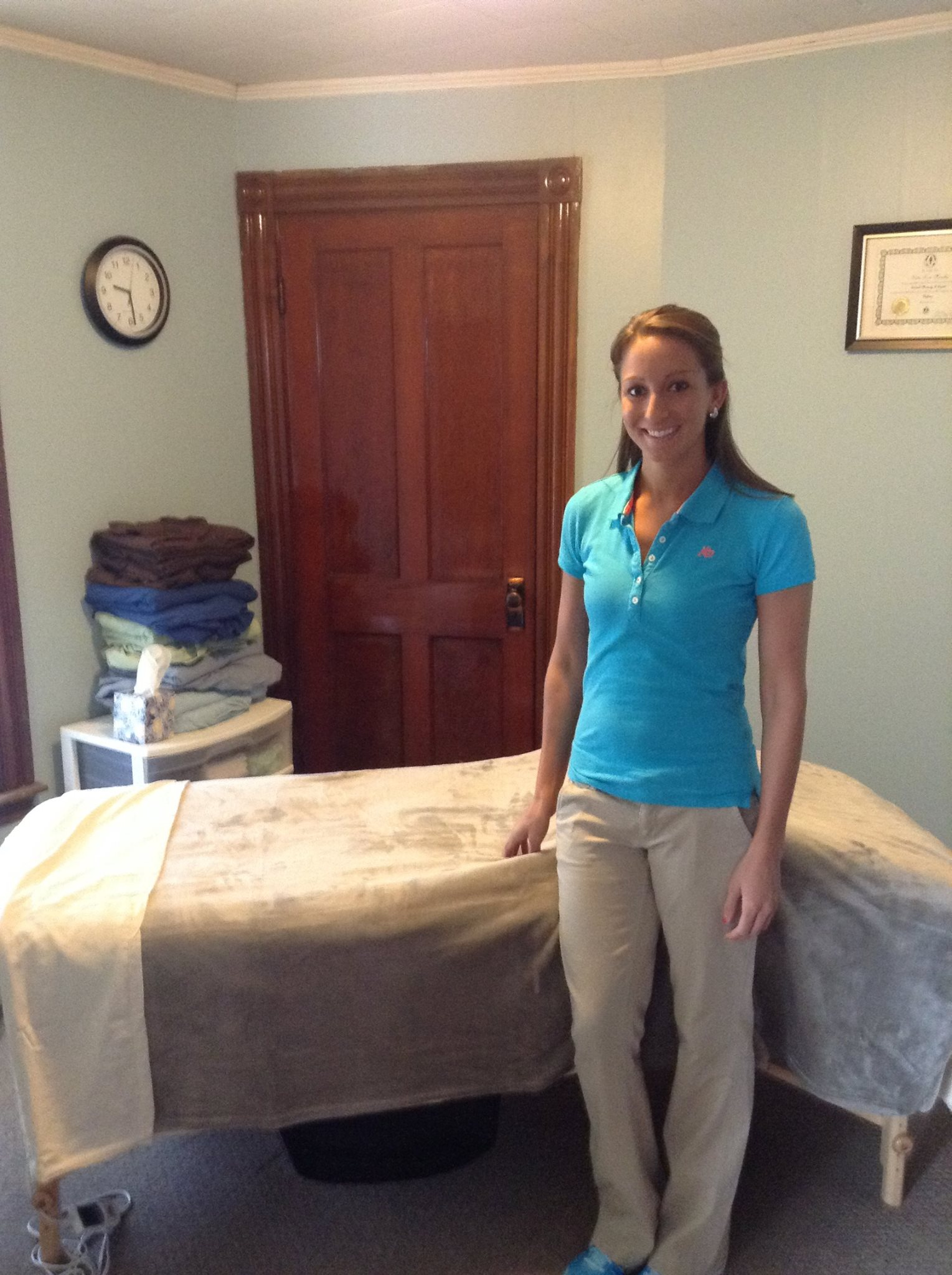 Katie Murphy, Massage Therapist, standing in her treatment room Brewer Maine 2014