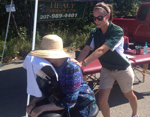 Katie, LMT providing Chair Massage at the Brewer Days Car Show 2014